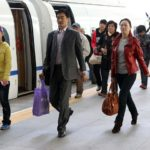 Passengers disembark from a train in Tianjin, China. Photo by Yang Aijun/WorldBank/Flickr. Cropped.